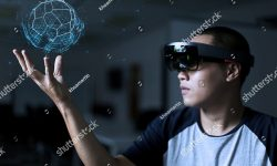 stock-photo-playing-magic-virtual-reality-with-hololens-643550962